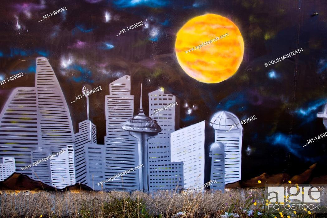 Stock Photo: Street art, graffiti, cityscape and full moon, near railway tracks, Christchurch, New Zealand.