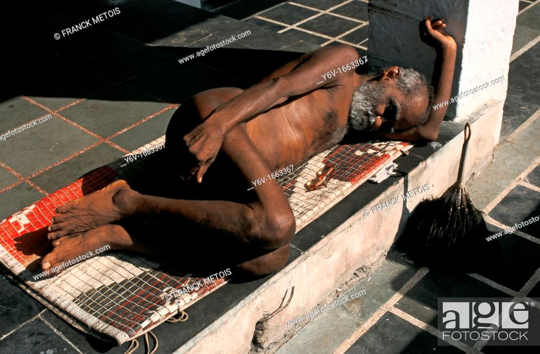 Stock Photo: A naked man is sleeping  He is a jaïn monk belonging to the digambar sect  From India.