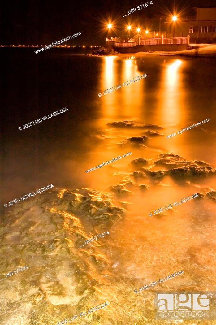 Stock Photo: Paseo Marítimo streetlamps reflections in El Mojón beach. Alicante province. Spain.