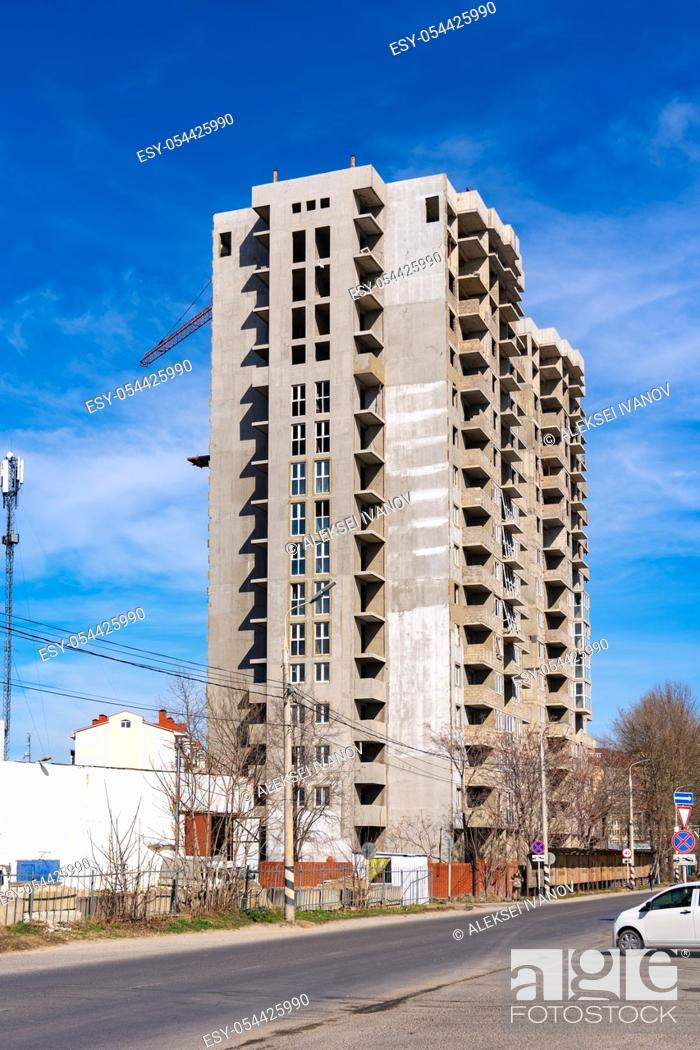 Stock Photo: Abandoned and unfinished construction of a multi-storey residential building.