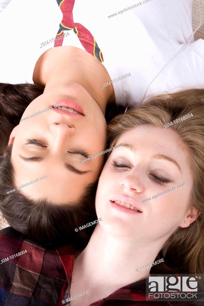 Stock Photo: Two young women lying together with face to face.
