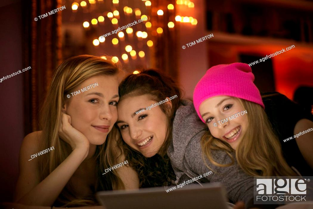 Stock Photo: Portrait smiling teenage girls using digital tablet.