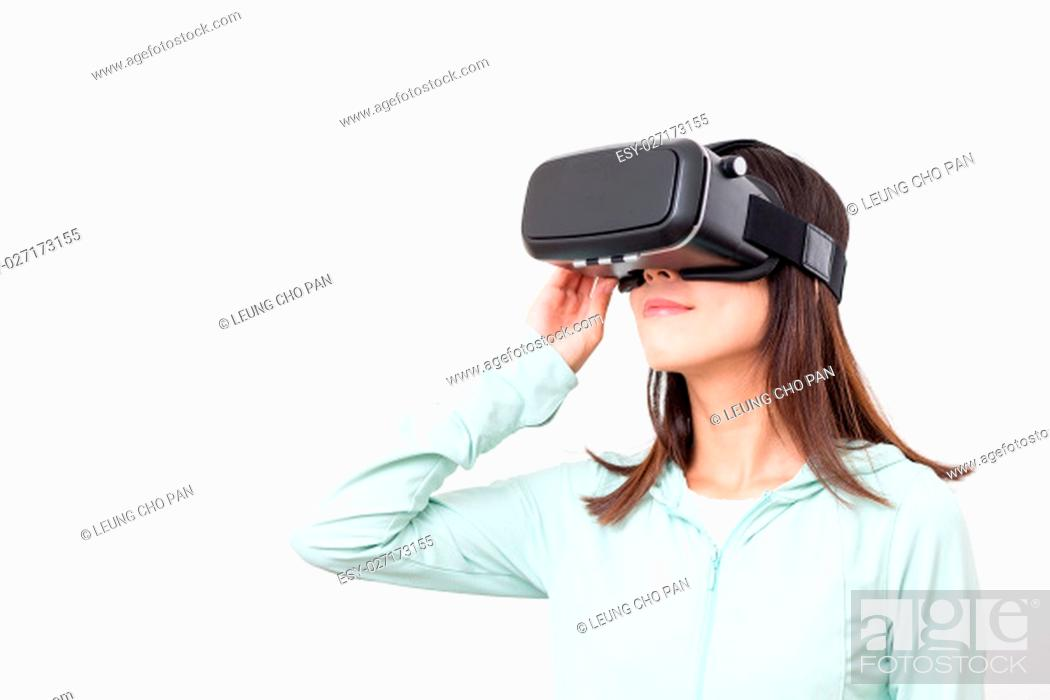 Stock Photo: Asian woman experience though VR glasses.