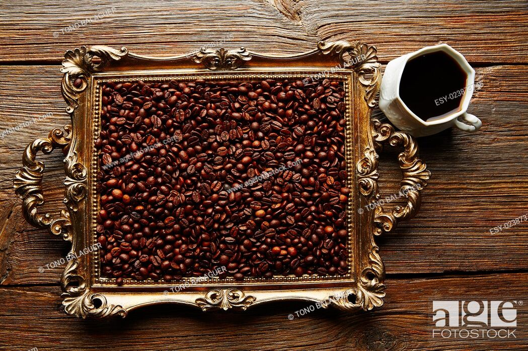 Stock Photo: Coffee cup and beans on vintage golden tray in wooden old table.