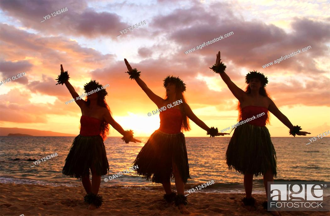 Stock Photo: Three hula dancers at sunset at Palauea, Maui, Hawaii.