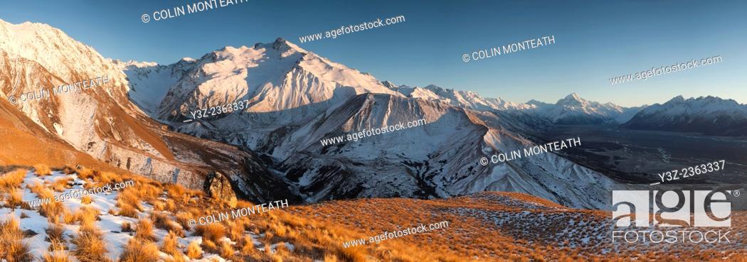 Stock Photo: Dawn, Tasman glacier river flats, Lake Pukaki, Glentanner high country farm, Aoraki / Mount Cook in distance, panorama from Ben Ohau Range, Mackenzie country.