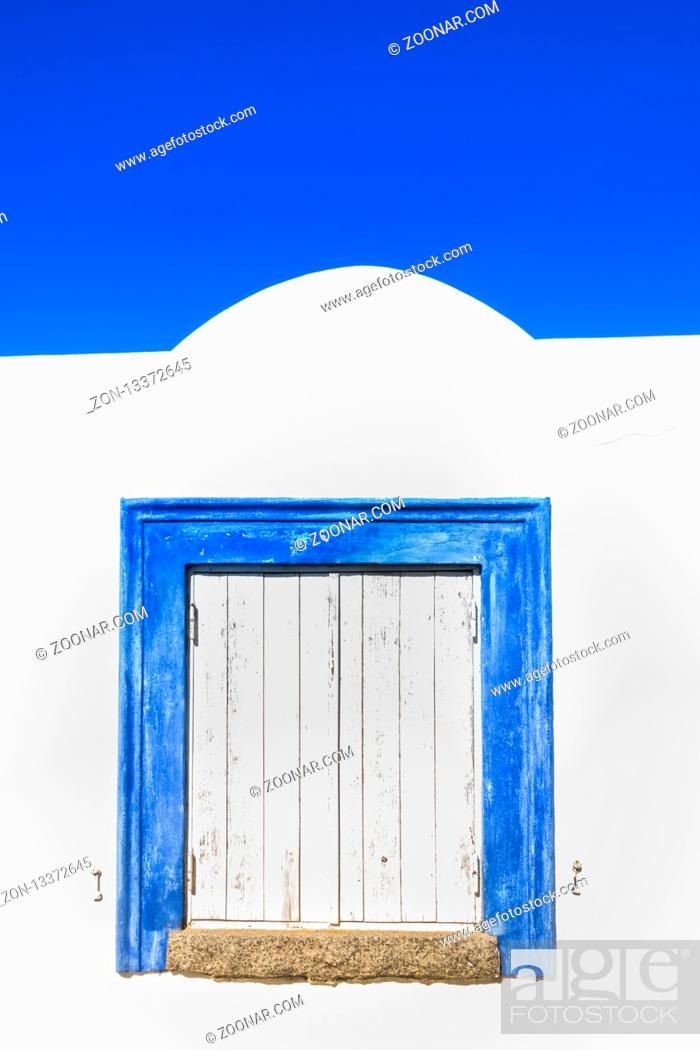 Stock Photo: historic algarve architecture building with blue framed window, praia da rocha, portimao, algarve, portugal.