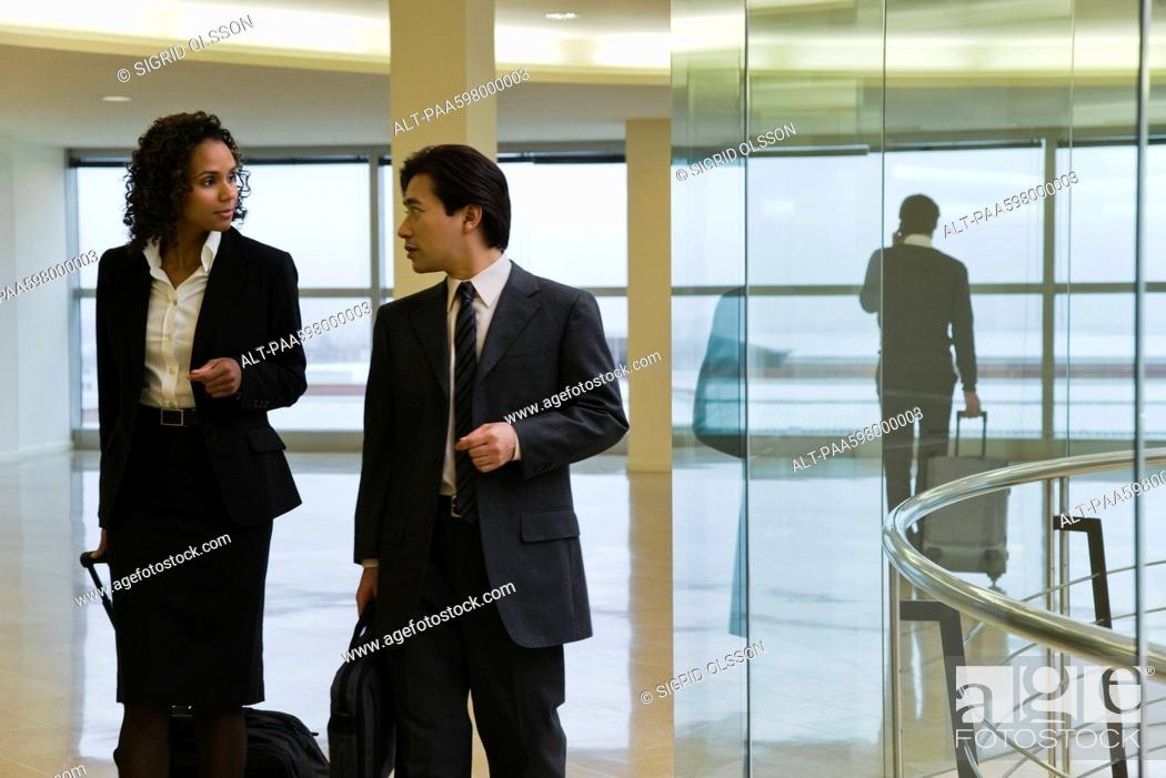 Stock Photo: Executives walking and talking.