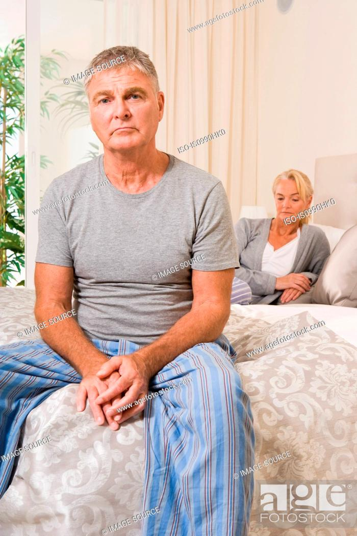 Stock Photo: Worried couple in bedroom.