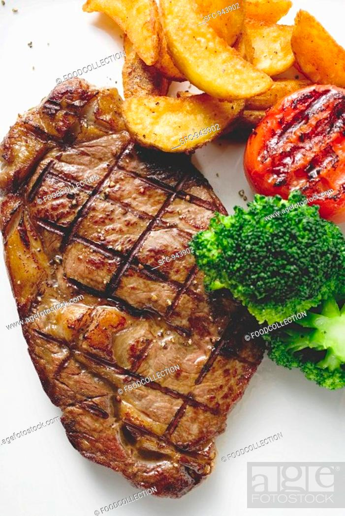 Stock Photo: Grilled rump steak with country potatoes and vegetables.