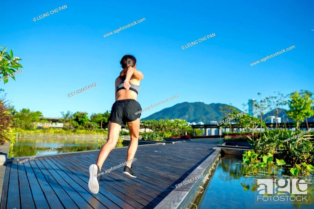 Stock Photo: Runner athlete running at park.