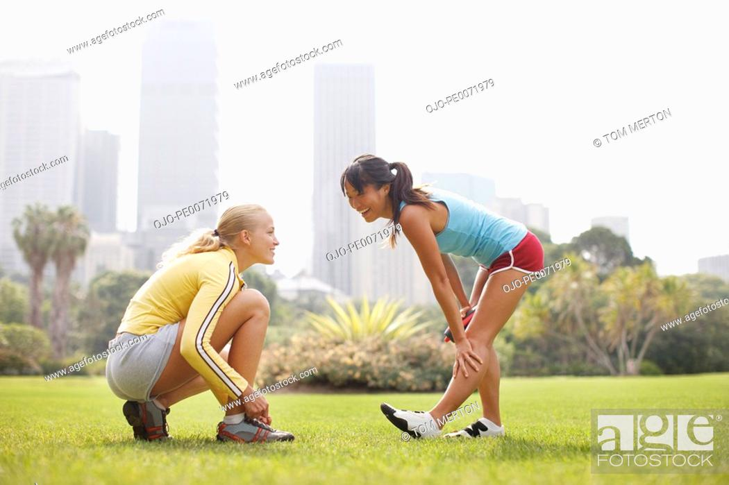 Stock Photo: Friends preparing for exercise in park.