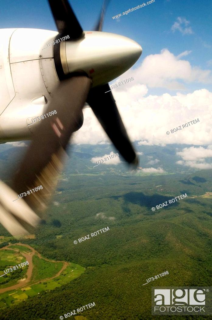 Stock Photo: A view from an ATR 72 airlplane above the forests of North Thailand.