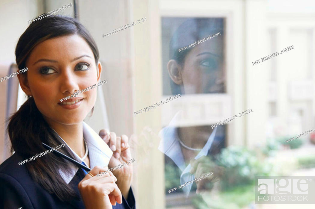 Stock Photo: Close-up of a businesswoman looking away.