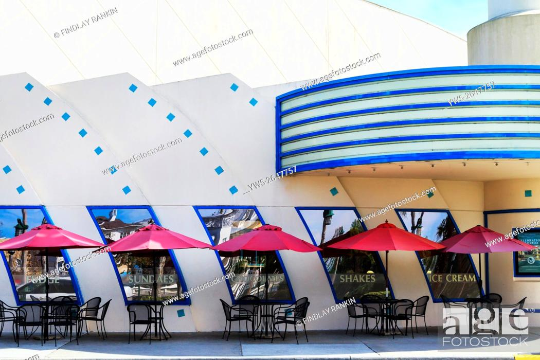 Stock Photo: Cafe tables and chairs outside the Art Deco cinema in Celebration, Osceola County, Florida, America, USA.