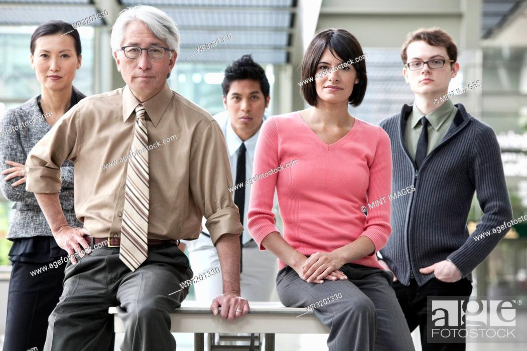 Stock Photo: A team portrait of a mixed race group of business people with an Asian businessman in the lead.