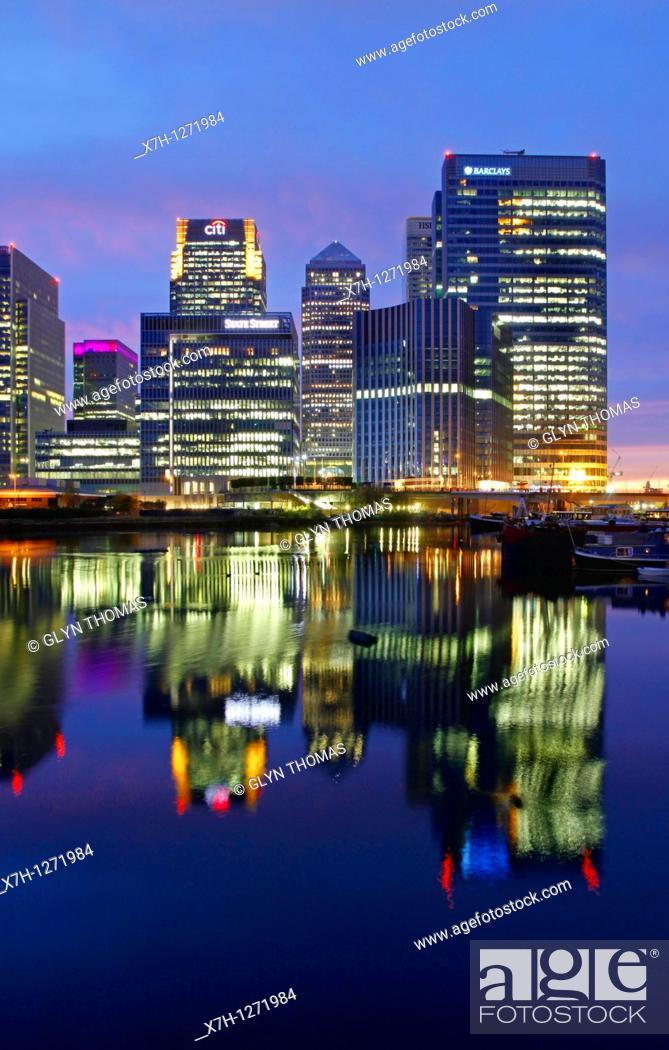 Stock Photo: Canary Wharf viewed at night from Blackwall Basin, London, England.
