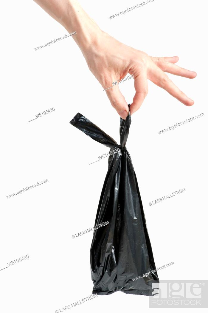 Stock Photo: Hand holding Garbage Bag.