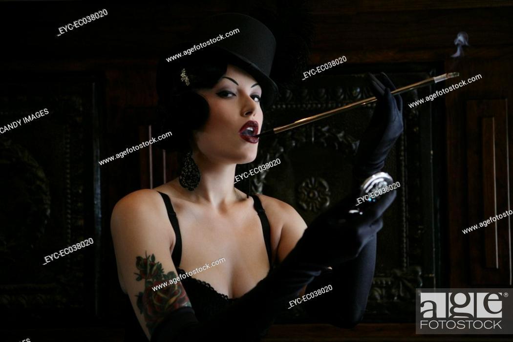 Stock Photo: Young sexy woman smoking in burlesque bar.