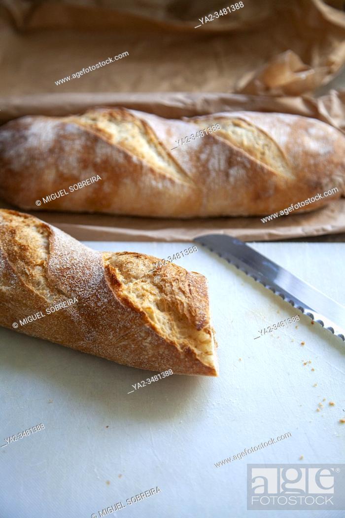 Stock Photo: Baguette Bread on Breadboard.