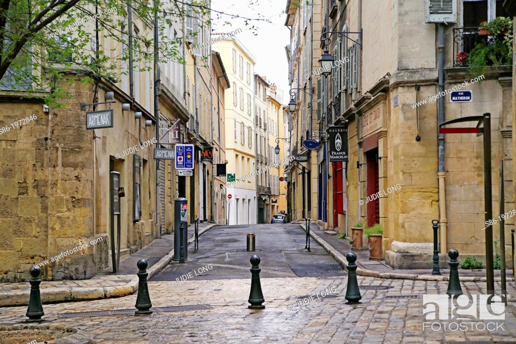 Stock Photo: Small Town Square Bordering Rue Matheron, Aix-en-Provence, Provence, France on a Reiny April Sunday.