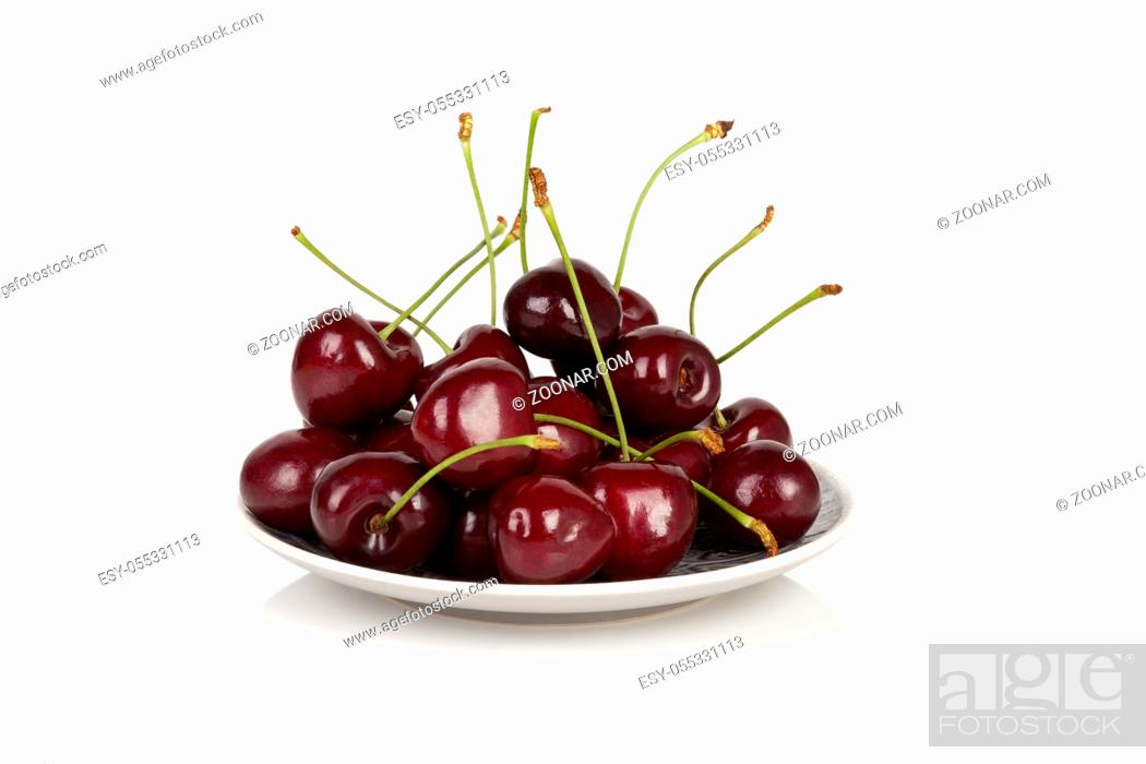 Stock Photo: Delicious cherries on white plate isolated on white background.