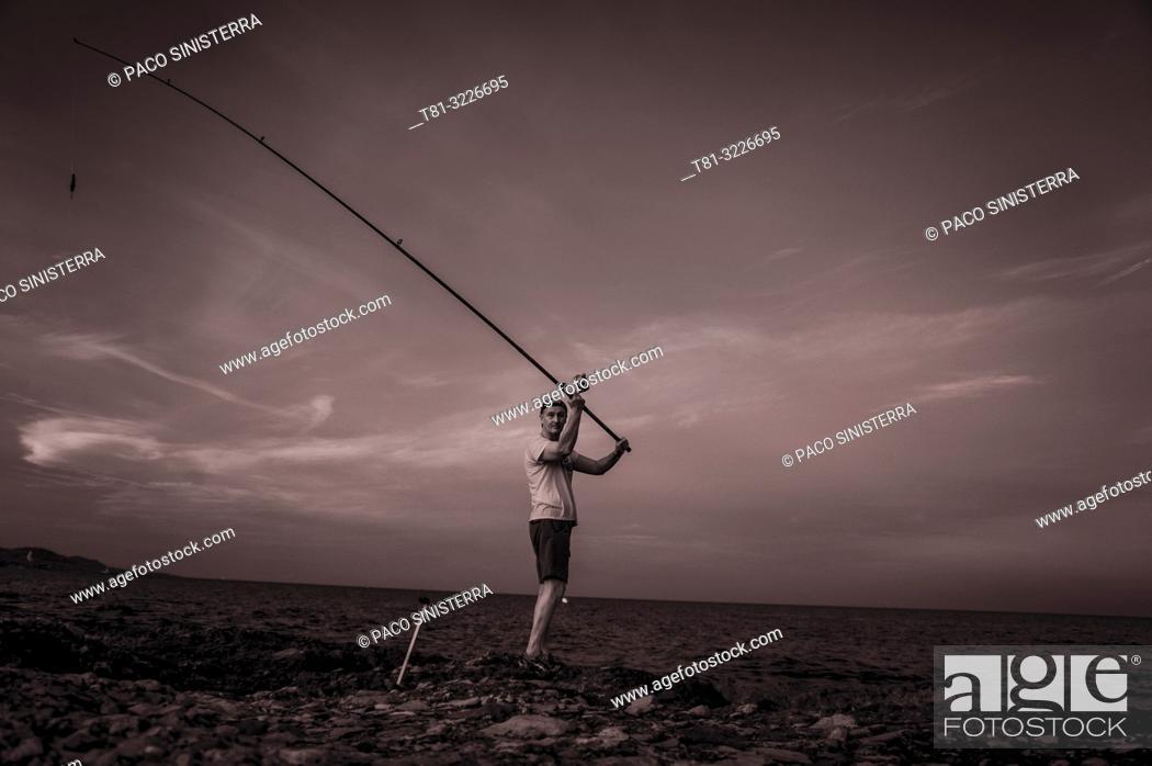 Stock Photo: Fisherman throwing the fishing rod, Alcocebre, Castellon province, Valencian Community, Spain.