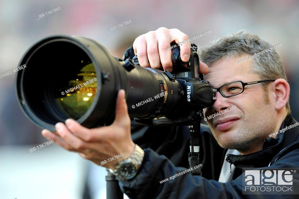 Stock Photo: Press photographer, sports photographer, Nikon D3 400mm lens.