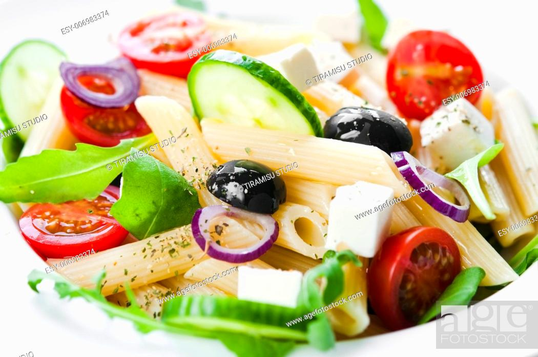 Stock Photo: Pasta salad with tomato, black olives, arugula and feta cheese.