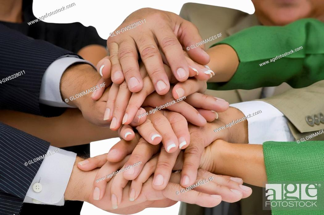 Stock Photo: Close-up of business executives stacking hands.
