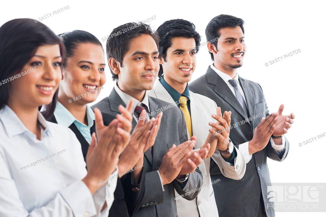 Stock Photo: Business executives applauding.