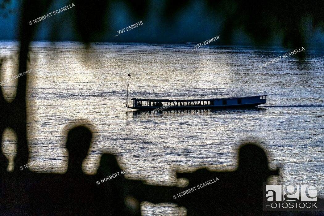Stock Photo: Asia. South-East Asia. Laos. Province of Luang Prabang, city of Luang Prabang, World heritage of UNESCO since 1995. Boat on the Mekong.