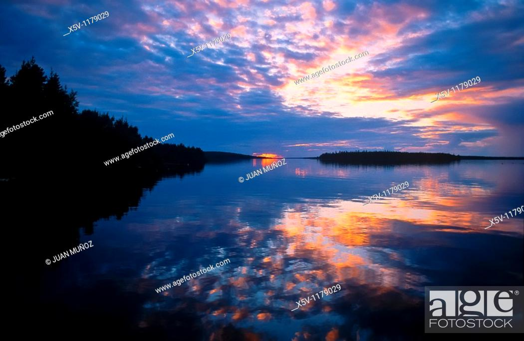 Stock Photo: Red and blue sunset on Lake Unari, Lapland, Finland.