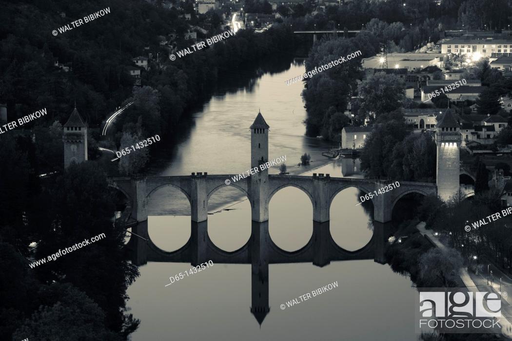 Stock Photo: France, Midi-Pyrenees Region, Lot Department, Cahors, Pont Valentre, midieval bridge, Lot River, dusk, elevated view.