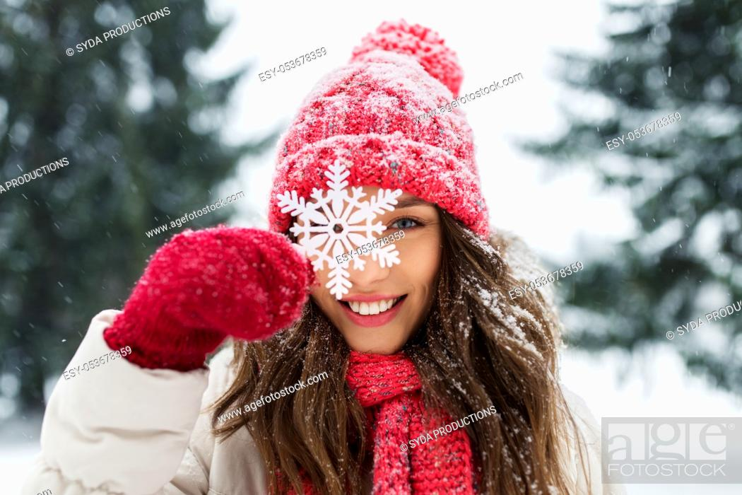 Stock Photo: portrait of teenage girl with snowflake in winter.