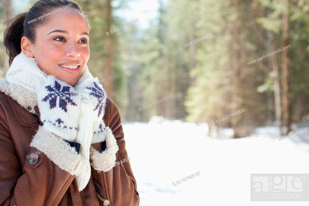 Stock Photo: Smiling woman in snowy woods.