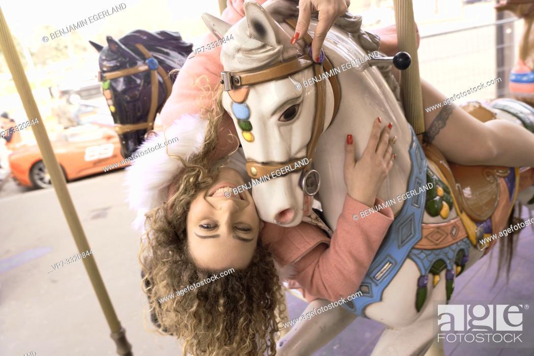 Imagen: woman at amusement Carousel, in Paris, France.