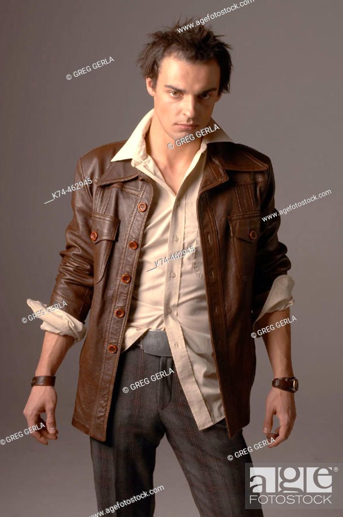 Stock Photo: fashion image of young man in leather jacket.