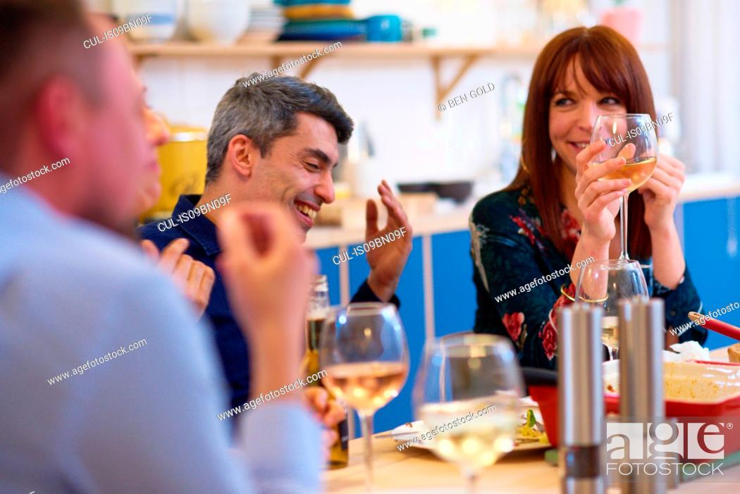 Stock Photo: Friends talking at dinner party.