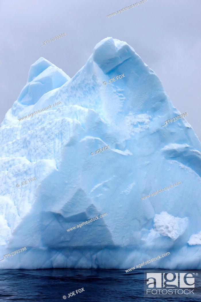 Stock Photo: pinnacle pyramid shaped aged iceberg near cuverville island Antarctica.