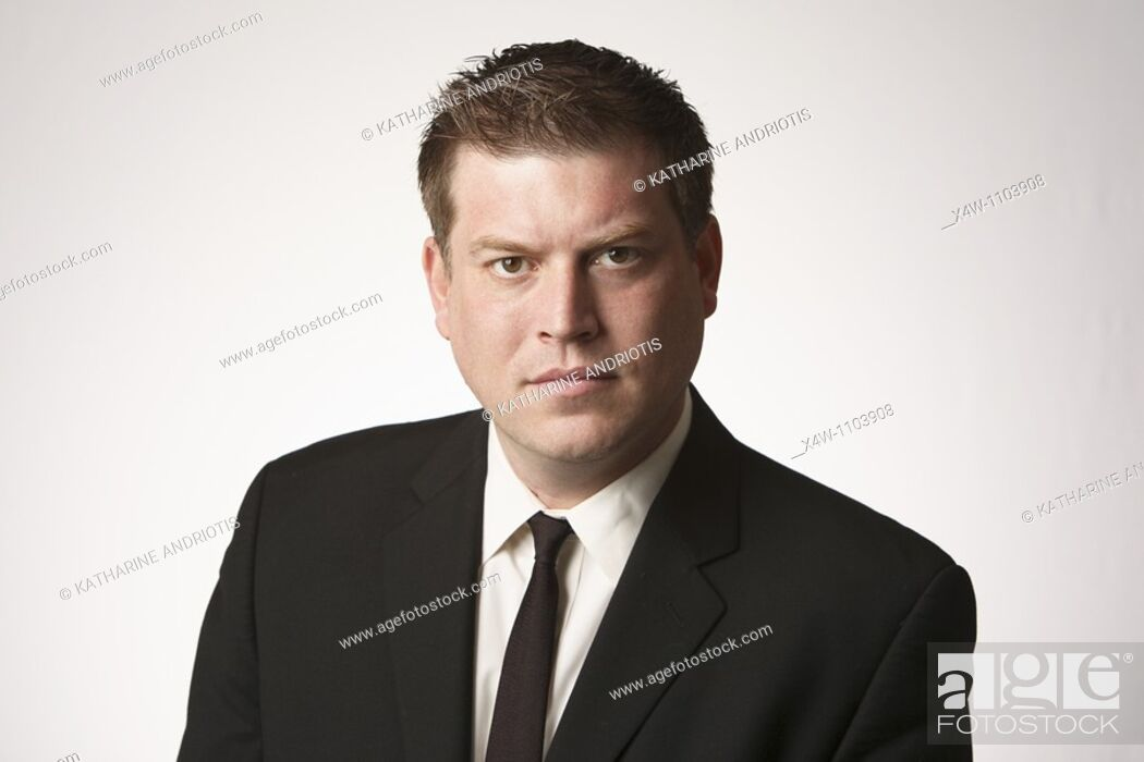 Stock Photo: Serious midadult man wearing black suit and tie.