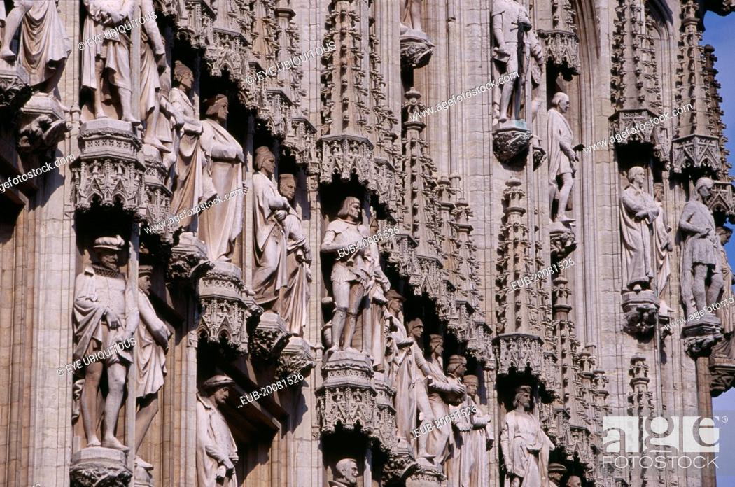 Stock Photo: Grand Place. Hotel de Ville detail of facade decorated with statues representing the Dukes and Duchesses of Brabant. Stadhuis15th Century.