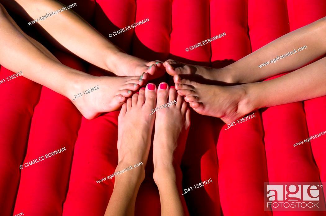 Stock Photo: children feet on lilo wales.