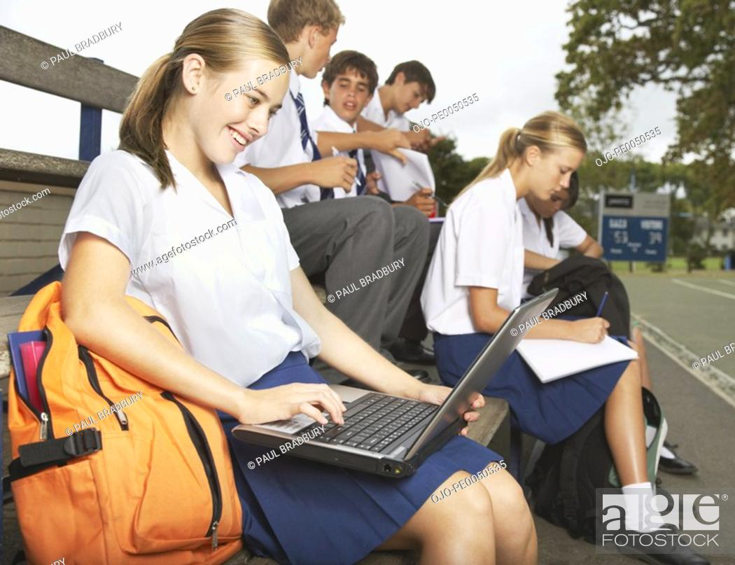 Stock Photo: Students outside their school studying.