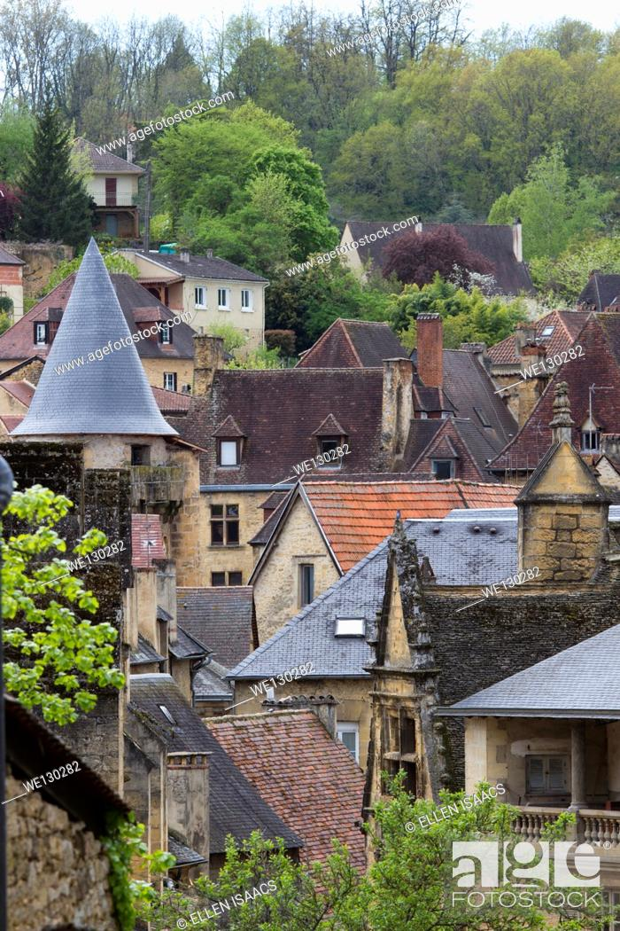 Stock Photo: Collage of red tile rooftops emerges from medieval sandstone houses in charming Sarlat, Dordogne region of France.