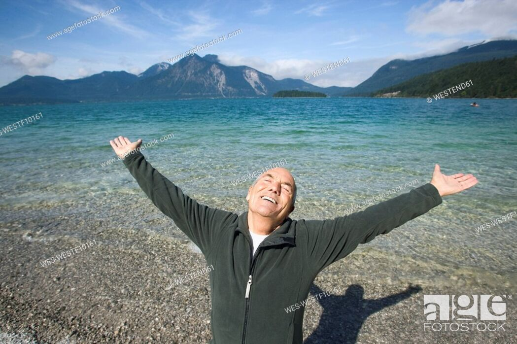 Stock Photo: Germany, Bavaria, Walchensee, Senior man cheering.