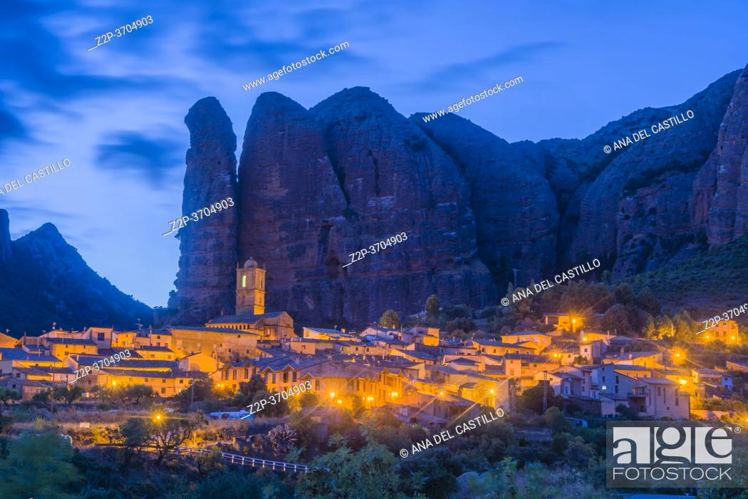 Stock Photo: Landscape of the Mallos de Aguero by night famous geological formations with the town of Aguero in the province of Huesca Aragon, Spain.