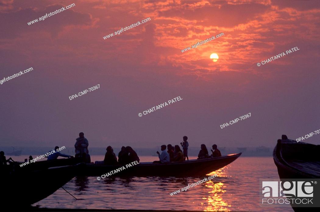 Stock Photo: Sunrise at the holy river ganga in the oldest Indian city of India , Banaras now Varanasi , Uttar Pradesh , India.