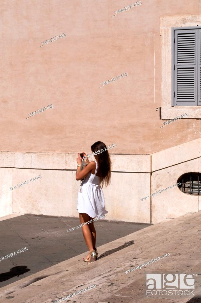 Stock Photo: Woman takes a photo at the steps of Quirinal square, Rome, Italy.