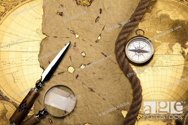 Imagen: Compass on the old map background.